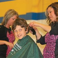 "STA Second grader Thomas' third year as a St. Baldrick's ""shavee"""